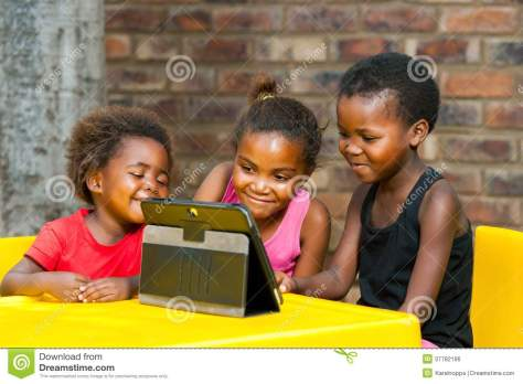 three-african-kids-playing-together-tablet-portrait-girls-leisure-games-37782196.jpg